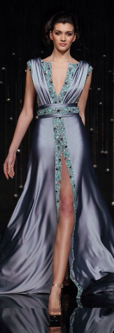 Jean Farres designed this beautiful empire waist line dress with a deep V neck