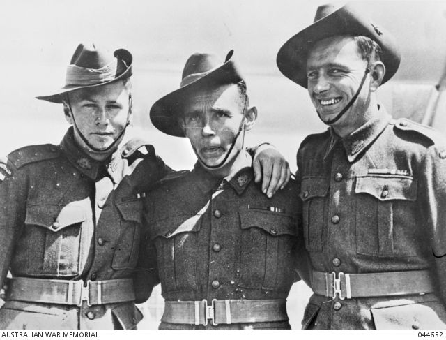 Three members of the Australian Army who were awarded the Victoria Cross for bravery in the Pacific Theatre and who were in Australia's Victory Contingent to Britain after the war. From the left they are Privates Frank John Partridge, Richard Kelliher and Sergeant Reginald Rattey. 044652 | Australian War Memorial