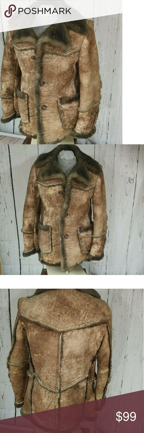 """Shearling sheepskin leather vtg distressed coat SM Gorgeous coat.  Genuine shearling sheepskin.  It is not in perfect condition.  There is a little of the fur missing here and there.  It just has a distressed look. It is marked a 36 which would be a men's small so a ladies medium.  Measurements are :40"""" chest,  38"""" waist, 30 1/2"""" length, 19"""" shoulders, 26 1/2"""" sleeves.  The color is tan and brown. Jackets & Coats Pea Coats"""