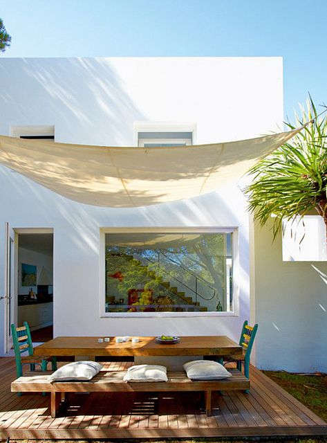 15 Dreamy Ideas for Outdoor Dining. liked the idea of using a sail as a canopy over the bed, or tied to the ceiling. battens and number would be so cool!