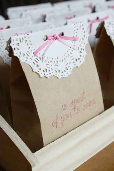 Favor bags - cheap and pretty! I've also seen them fastened with a clothespin instead of ribbon. Your tags would be cute on these, too (if you have enough of them).