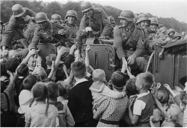 Ethnic Germans welcome German troops during the invasion of Poland, Sept 1939. The existence of large numbers of ethnic Germans in eastern Europe was one of Hitler's main excuses for launching the war.