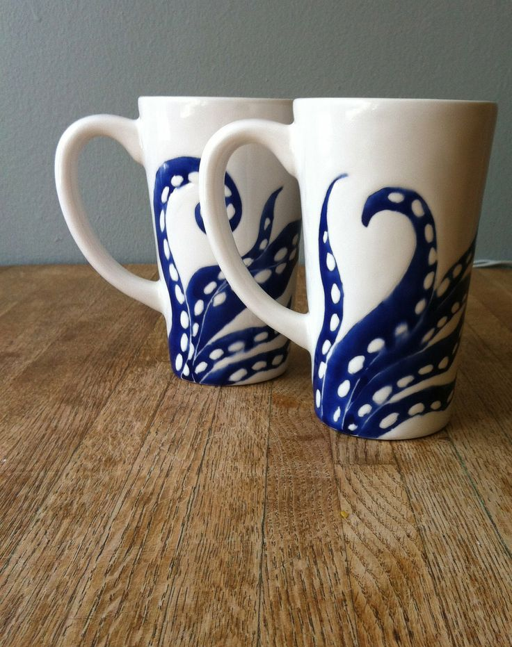 navy blue octopus legs tall ceramic coffee mugs. $62.00, via Etsy.