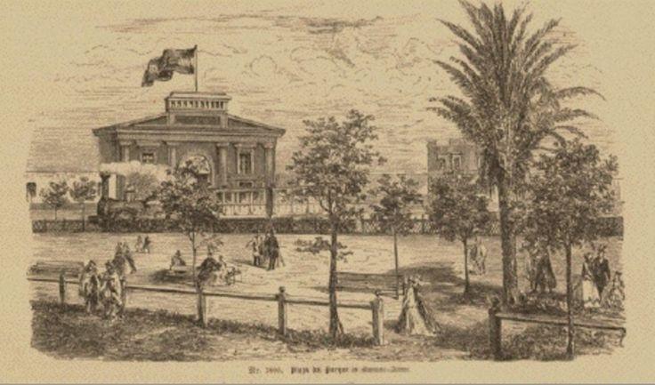 """1873. La """"Plaza del Parque"""" actual Plaza Lavalle. El edificio donde está enarbolada la bandera era el """"Parque de Artillería"""", en ese lugar hoy se encuentran los Tribunales."""