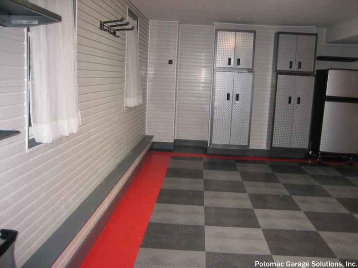 We do not see padded tile floors often in a remodeled garage but we see the appeal. The average price to install a new garage door is $964.