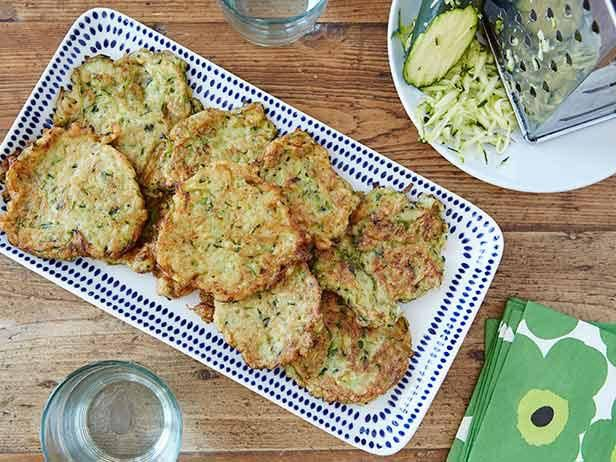 Zucchini Pancakes : Ina admits that zucchini can be a bit boring, but it takes on new life as a dinner side dish when paired with red onion in pancake-form.