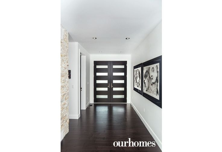 The linear lines that are a hallmark of the Prairie School are reinforced by the custom-made mahogany front doors with etched glass.  http://www.ourhomes.ca/articles/build/article/artistic-vision-meets-frank-lloyd-wright-architecture