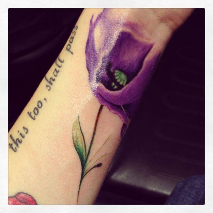 Purple poppy flower tattoo on wrist