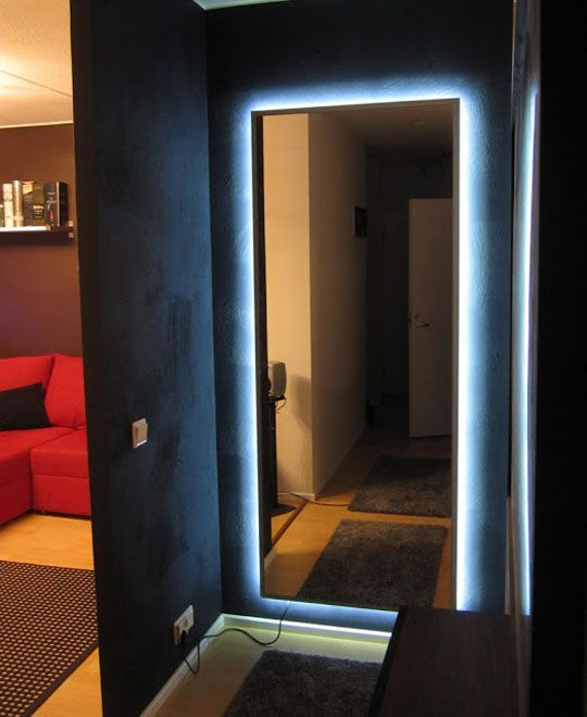 IKEA Mirror Transformed With Nightclub Chic LED Lighting IKEA Hackers.  Such a great idea, but why wouldn't you hide the socket behind the mirror?!