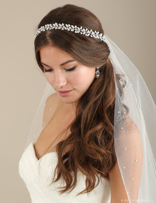 Bel Aire Bridal, style #6640 in the Gold color and retails for $180. Enhance your bridal ensemble wearing a glittering wired garland with tiny pearl clusters and marquise rhinestones. This gorgeous tie headband is available in shimmering silver or warm gold so you can customize your look. Enjoy your special day with a headpiece worthy of the occasion.