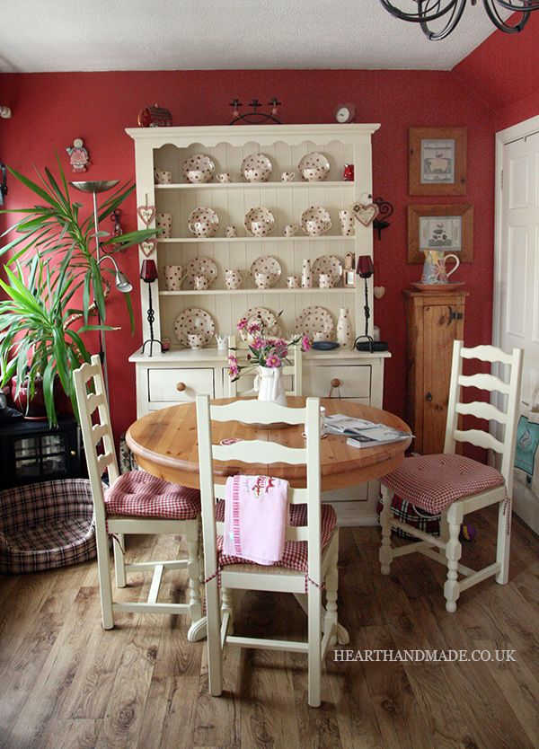 Red walls & chintz snack set.  With the white furniture & natural wood, this is cozy & happy.  I think I'd have a green or blue instead of red...