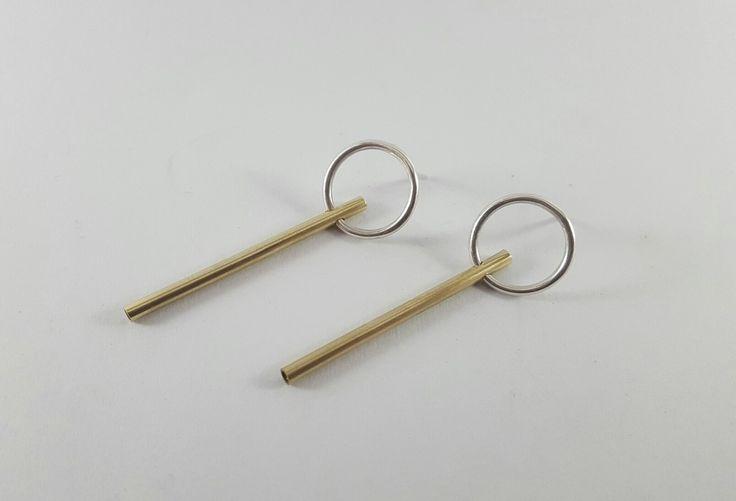 Circle studs with golden bar, R220.00