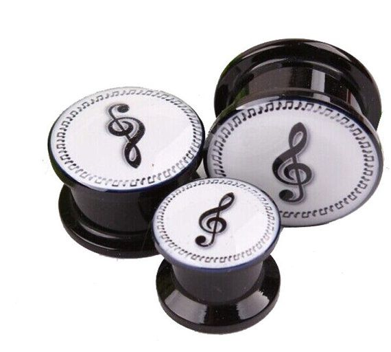 Treble Clef and Notes Ear Plug Expander Tunnel   Funky black and white design muisc notes and treble clef ear plug tunnel body jewellery.  Now your stretched look can be in true musical style.  Perfect for our music lovers and musicians.  These saddle fit expanders are available in sizes 4mm - 16mm.  We advise these plugs are used in healed piercings.  *Price is per Plug  Material: Acrylic  These funky plugs are a thread screw on and off style