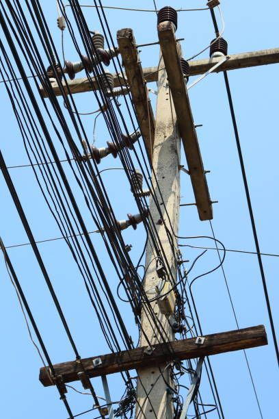 power poles and many telephone lines in the communication era without