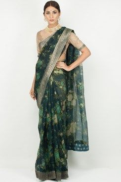 Featuring a prussian blue and beige floral printed organza saree with a black…