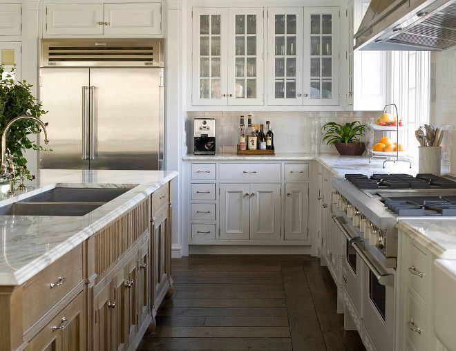 Light wood kitchen island and white cabinets