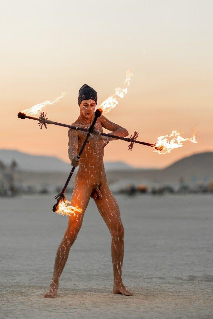 Arab fack burning girl man body paint wet