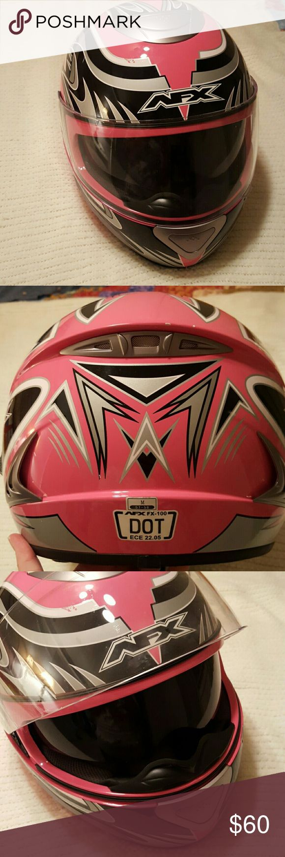 AFX DOT motorcycle helmet with duel visor. Pink, silver, black graphic DOT AFX motorcycle helmet.  It does have some scratches in the graphics, mostly from being stored. There is one minor scratch on the visor and some wear on the cushion where it has set in storage.  Feel free to make me an offer. I can take additional pictures if anyone is interested. AFX Other