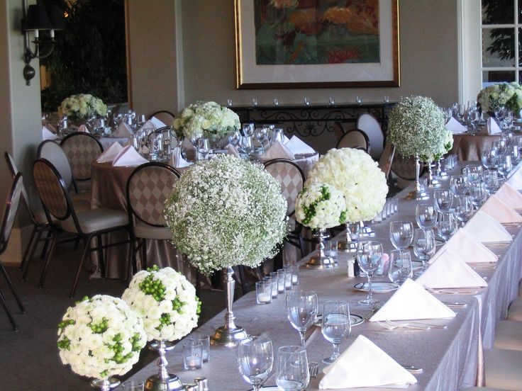 Floral orbs of roses, Baby's Breath and button mums with hypericum down the head table.  Broadmoor Golf Club. By Fiori Floral Design, Seattle