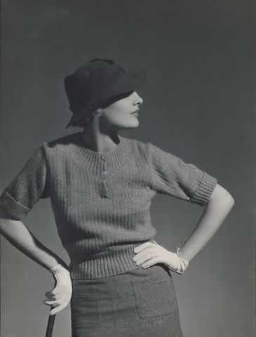 Model is wearing a golf outfit, with hat by Rose Descat and knitted sweater with gloves by Hermes, 1933. Photo by George Hoyningen-Huene.