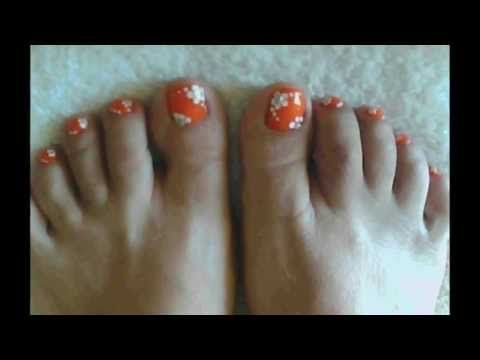 Eye Catching Orange Toe Nail Art Designs With Pretty White Flower Motif For Summer