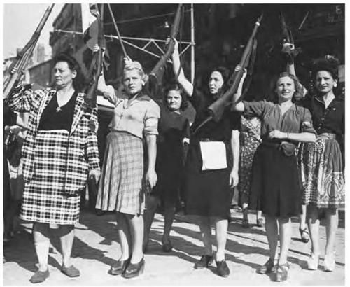 Female members of the French Resistance celebrate the liberation of Marseille by French and US forces, August 1944