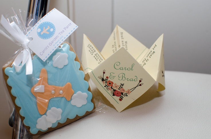 Hand made travel cookies and a 'do you know the bride to be' questionnaire as a cootie catcher :)