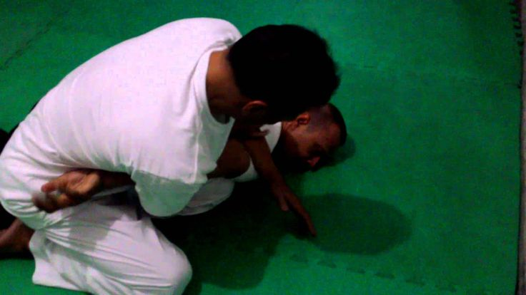 Pencak Silat: How to escape from an arm lock?