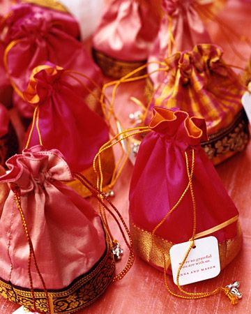 Favors consisted of bright silk bags made by Indian women who work for the Shanthimalai Handicrafts Development Society, a charity Anna supports; each holds a candle and a jar of jam.
