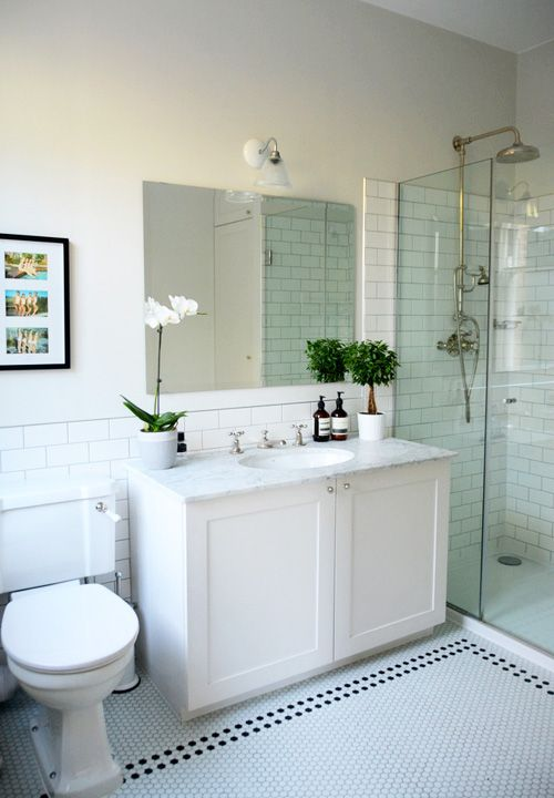 Idea for next bathroom, moving away from travertine! Love that it's classic, not ultra-modern. Especially the tiles and the shower head.