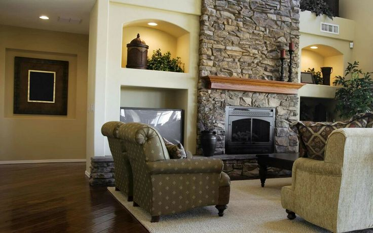 Stone wall back drop fire place on the living room