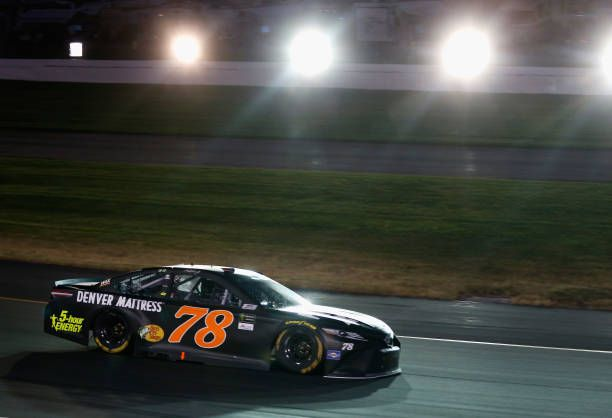 Martin Truex Jr driver of the Furniture Row/Denver Mattress Toyota races during the Monster Energy NASCAR Cup Series Quaker State 400 presented by...