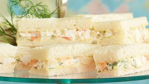 Australian tea sandwich recipes: Mixed sandwich plate consisting of Prawn and dill sandwiches, Roast beef and watercress sandwiches, and Smoked salmon and cucumber sandwiches.