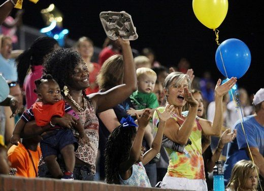 Daja Sexton holds her 6-month-old son Jamaal Sexton Jr. alongside Kelley Pruitt, who was attending the game with a group from Seacoast Church's North Charleston Dream Center as North Charleston took on RB Stall on Friday night. Sexton's cousin plays for the football team.