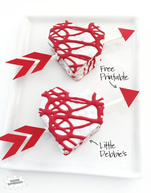 Turn Little Debbie Heart Cakes into Cupid's Arrow treats at a Valentine's Day Class party with this free printable from @PagingSupermom
