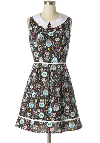 Supper cute novelty printed dress in black and multi-coloured skeleton kitty and pet fish prints. Peter Pan collar. Hip pockets. Back zipper. 100% cotton Not stretchy Not lined Hand wash cold; hang dry Women's Vintage-Style Dresses & Accessories - Canada Cosmic Kitty Dress -