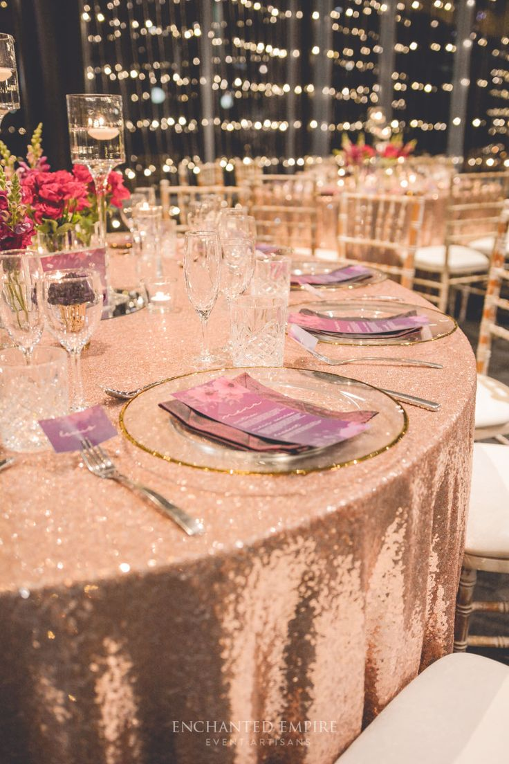 Rose gold sequin base was the perfect colour for this deep plum toned wedding. Limewash chairs, twinkling fairy lights added to the atmosphere of this beautiful style. Custom designed wedding stationery from menus, place cards, table numbers and deep rich plum and burgundy florals blended seamlessly with the colour palette . Thin gold rimmed glass charger plates with crimson pintuck napkins, added that extra elegant statement…
