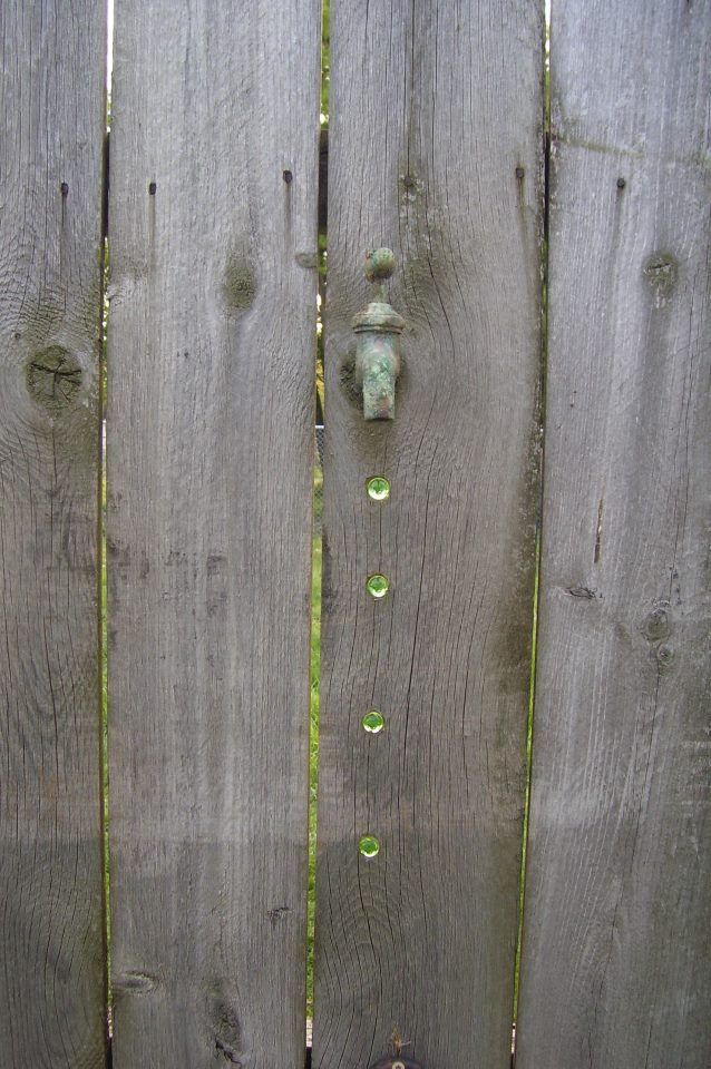 Fence art. Love this with the marble water drops!