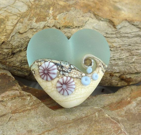 use this idea for mosaic...use light blue glass for top of heart... add beads