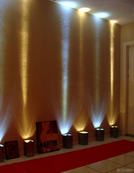 Awesome lighting idea without cords for a Hollywood party!  Big flashlights in kleenex boxes. -use lamp wire kits-