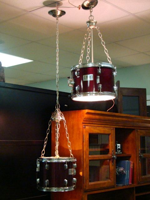 Hanging light fixture upcycled using drum set. Maybe for my hubby's man cave lol