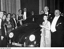 German Press Ball 1939. Dr. Ferdinand Porsche presents thhe Volkswagen tombola to Mrs. Elsa Ellinghausen, the lucky winner.