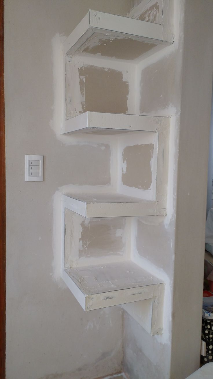 Built in drywall shelving.