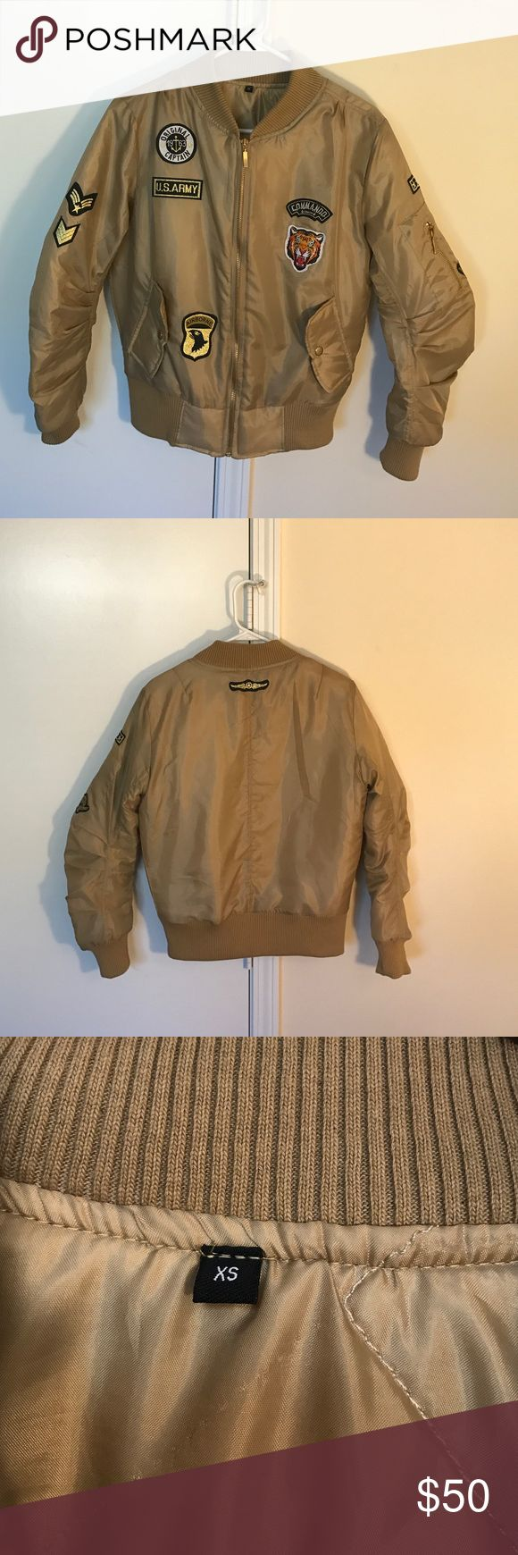 Tan/Brown bomber with patches XS but fits like a small. never worn, 100% polyester. Bought at Rasheeda's boutique store located in Phipps Plaza, in Atlanta, GA. Jackets & Coats Utility Jackets