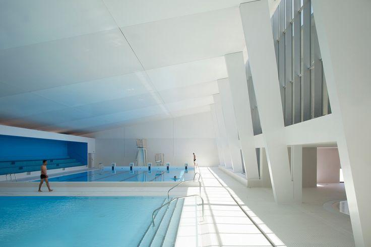 unforgettable ambiances, soft lighting, fluid architectural promenades, and curves: Swimming pool by Dominique Coulon et associés (Bagneux, Paris)