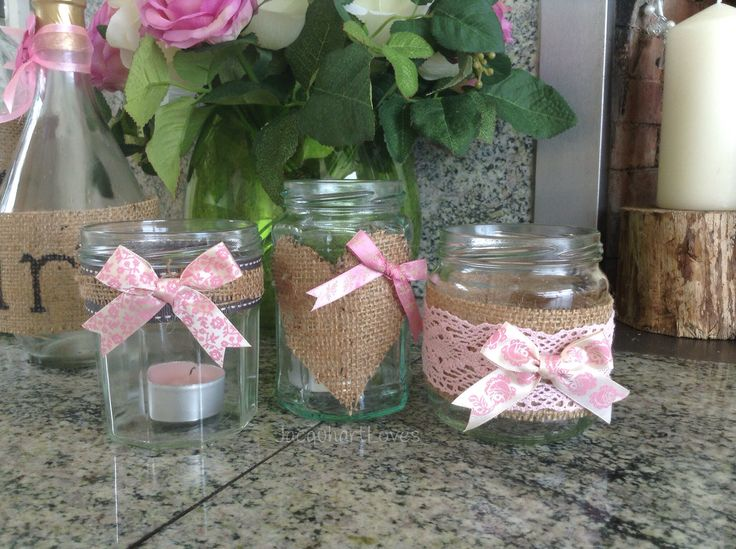 Wedding Inspiration - Homemade candle holders, made from jam jars and wine bottles, decorated with pink lace, pink bows, white ribbon, glitter and hessian fabric.