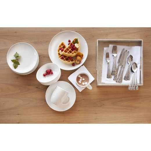 The Threshold Coupe Salad Plate Set of 4 in White provides a bright, clean slate from which your starter course can come to life. There's something to be said for the quiet beauty of white porcelain. It's perfectly stylish and minimal while showcasing salad, sushi or canapés. This neutral look builds intrigue when paired with alabaster linens and candles, or let it play the supporting role amongst primaries or patterns. Dishwasher safe.