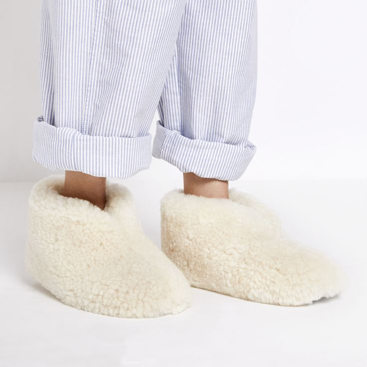 It's no overstatement when we say these shearling slippers feel literally as if you're walking on a cloud. The danger is that once you've worn them, you...