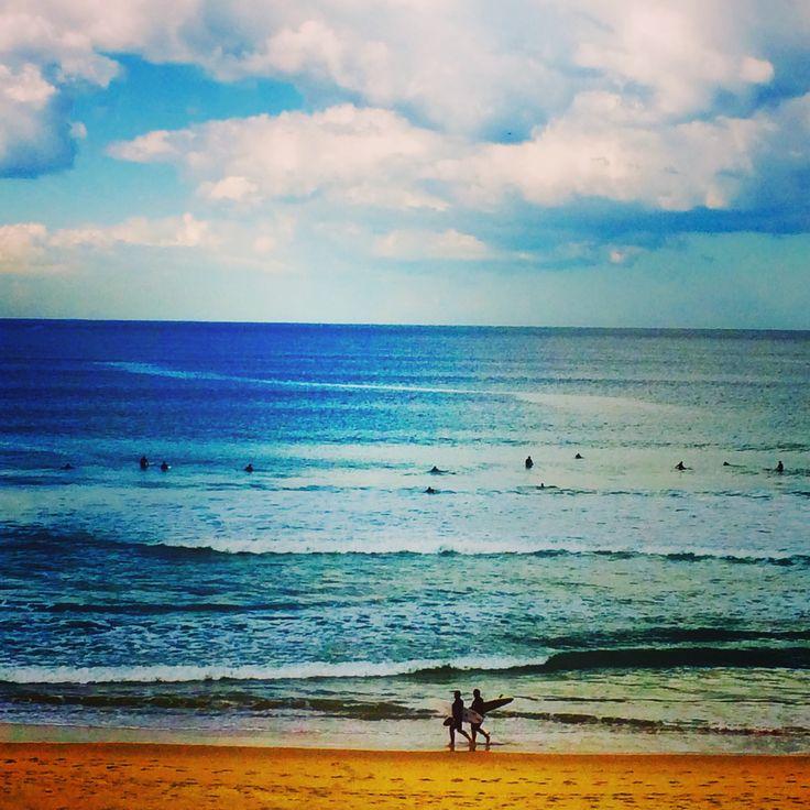 Warming sunshine brr dip ocean. Pumping swell whew.
