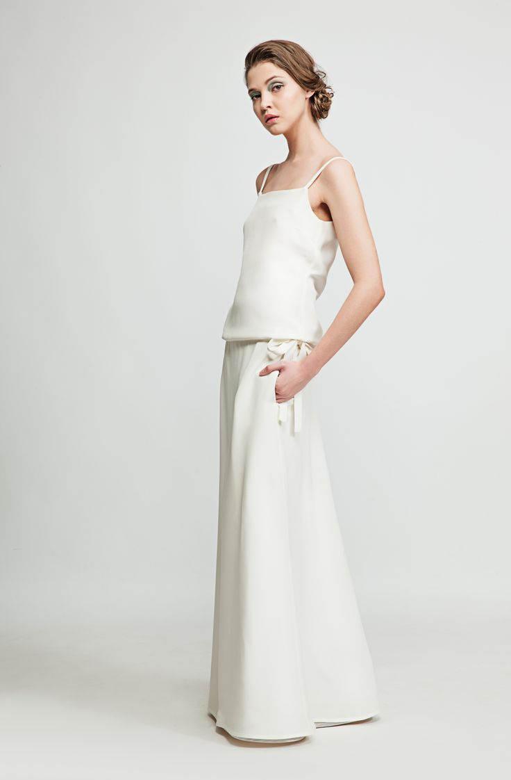 This elegant natural white gown is made out of Cady couture silk and is a hit at every summer event. Wear with sandals for more laid back get-togethers and with heels for a more formal look. www.marimofashion.com